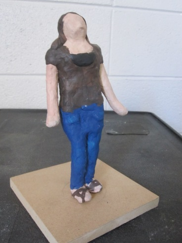 Sarah D., Modeling clay, Self-portrait, Figures, Fall 2013